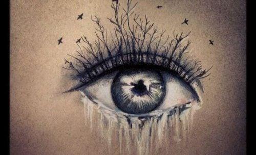 Płaczące oko z gałęziami zamiast rzęs