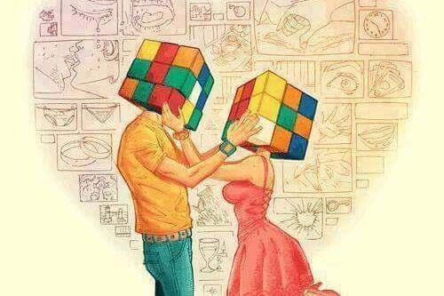 Nieporozumienia - para z kostkami Rubika zamiast głów.