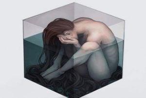 Depresja - kobieta zamknięta w sześcianie.