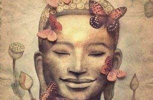 Trening uważności - Budda , motyle i kwiaty.