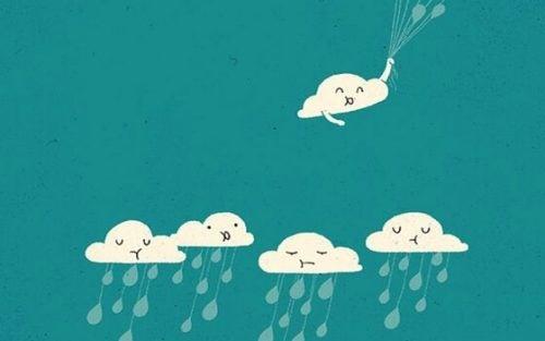 Deszczowe chmury i uśmiechnięta chmurka