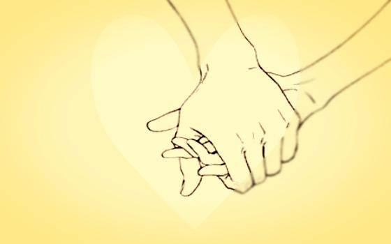 Uściśnięte dłonie.
