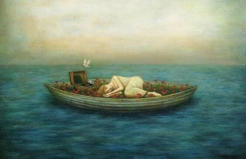 Naga kobieta w łodzi.