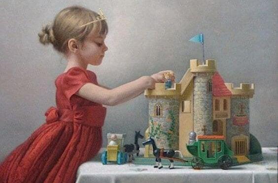 Dziewczynka budująca zamek.