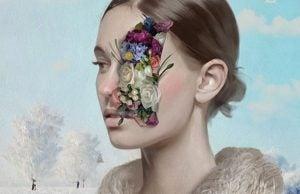 Dziewczyna i kwiaty na twarzy.