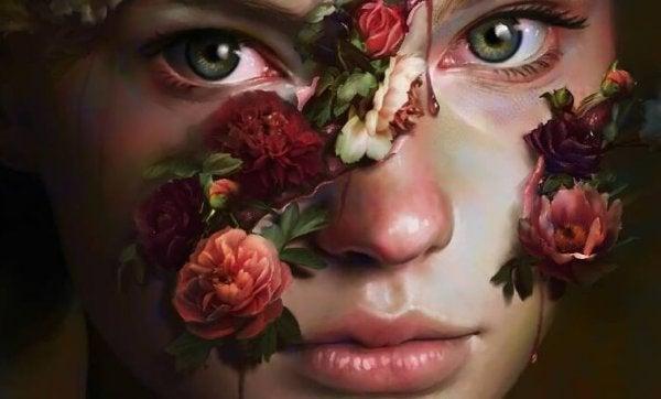 Dziewczyna z kwiatami na twarzy.