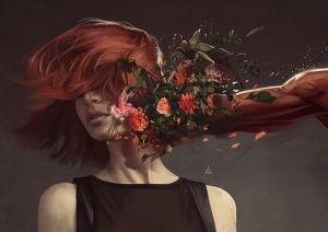 Dziewczyna uderzona pięścią owiązaną kwiatami.