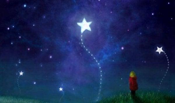 Dziecko i spadająca gwiazda.