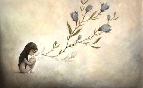 Inteligentni ludzie - dziewczyna kuca przy drzewie