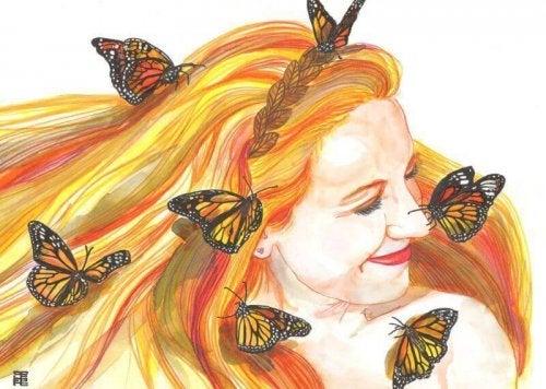 Szczęśliwa kobieta z motylami we włosach.