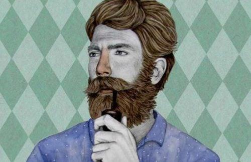 Mężczyzna z brodą i fajką myśli