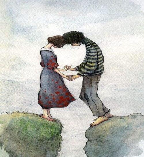 Miłość - Para trzyma się za ręce nad urwiskiem
