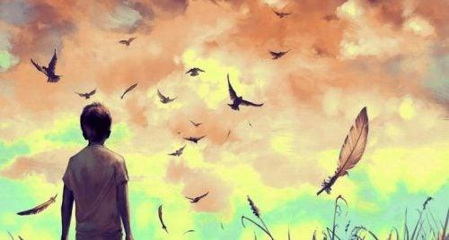 Pokonać smutek - chłopiec i czarne ptaki