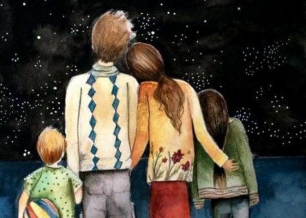 Szczęśliwa rodzina patrząca w gwiazdy.