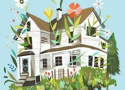 Dom z kwiatami w oknach.