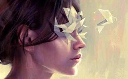 Dziewczyna i papierowe ptaki.