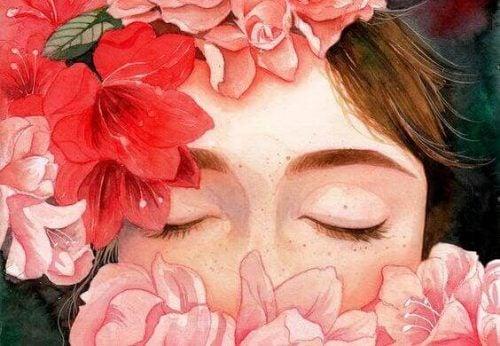 Dziewczyna z twarzą ukrytą wśród kwiatów