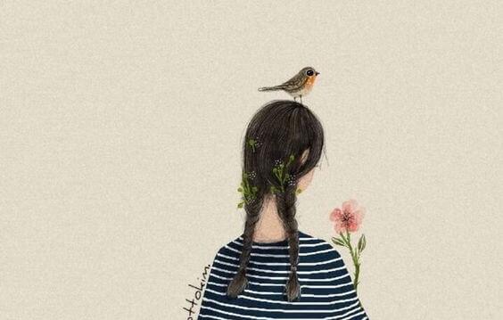 Dziewczynka z ptaszkiem na głowie.