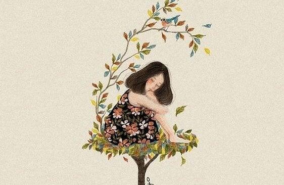 Smutna kobieta na szczycie drzewa.