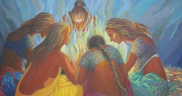 Kobiety przy ognisku.