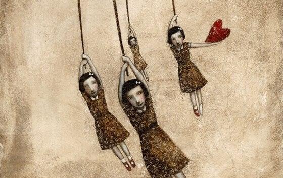 Dziewczynki na sznurkach i serce.