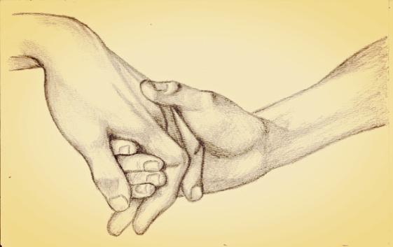 Złączone dłonie.