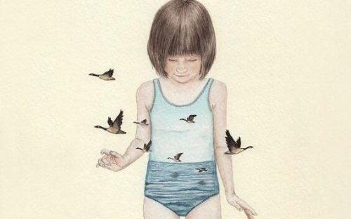 Dziewczynka otoczona przez ptaki
