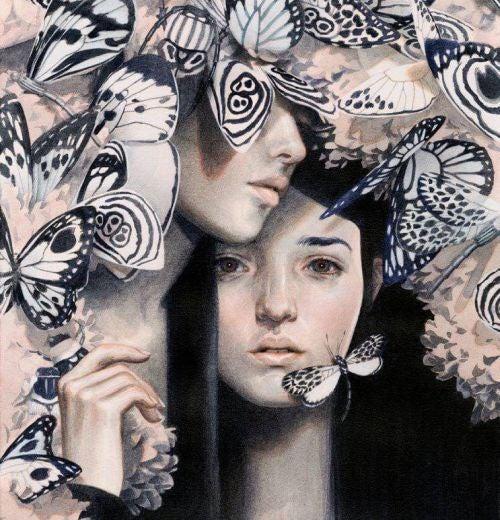 Para ze złamanym sercem wśród motyli