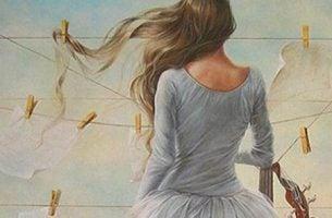 Kobieta stoi tyłem do wiatru - życie to konsekwencje, nie nagrody i kary