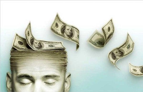 Mężczyzna z głową z pieniędzy.