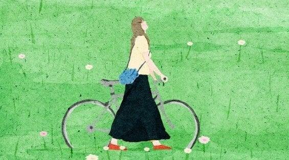 Kobieta z rowerem.