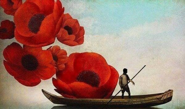 Mężczyzna na łódce i maki.