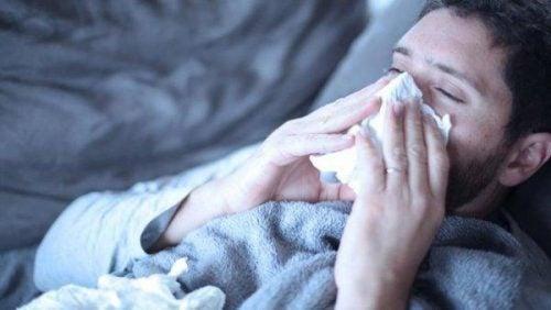 Wpływ stresu na ciało - przeziębiony mężczyzna