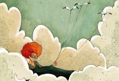 Kobieta siedzi w chmurach i trzyma ptaki na smyczy