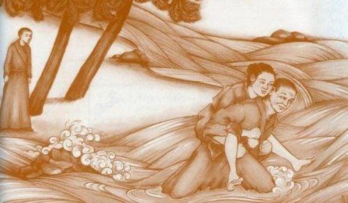 Mnich niesie na plecach kobietę