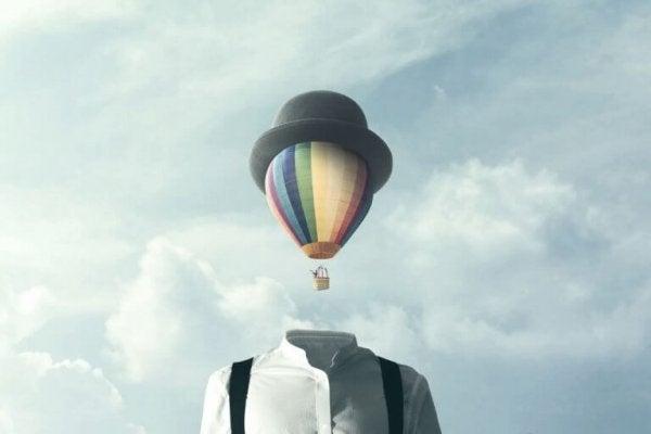 Mężczyzna z balonem zamiast głowy.
