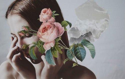 Twarz kobiety za kwiatami