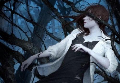 kobieta pomiędzy gałęziami - objawy depresji
