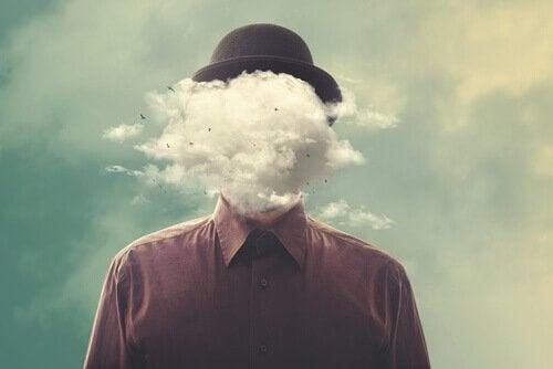 mężczyzna z głową w chmurach reprezentujący negatywne emocje