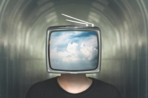 mężczyzna z telewizorem zamiast głowy
