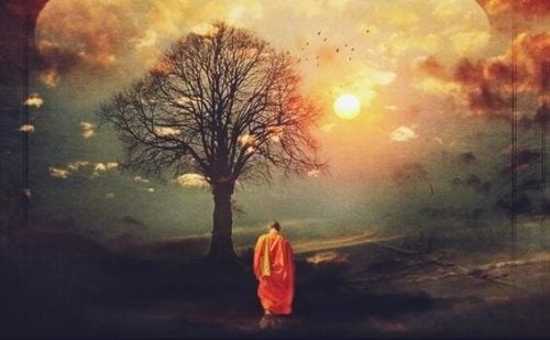 mnich buddyjski przy drzewie - filozofia wschodu