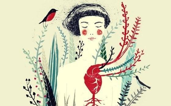 Kobieta z sercem, z którego wyrasta roślina.