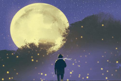 Osoba w szaliku patrzy na Księżyc.
