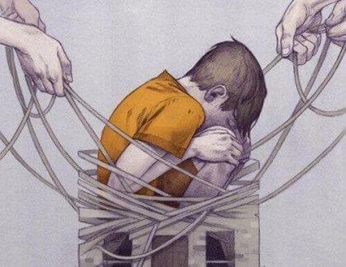Chłopiec oplątany sznurem - szkody emocjonalne