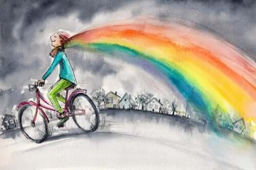 Chłopiec na rowerze z tęczą