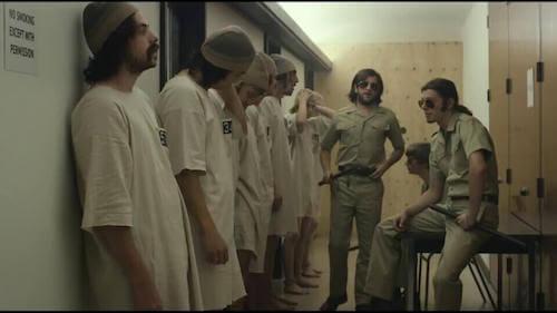 Strażnicy i więźniowie