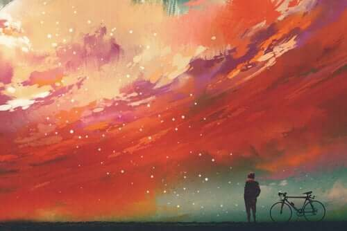 Człowiek na tle kolorowego nieba